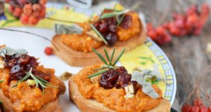 bruschetta with pumpkin and cranberry on wooden table