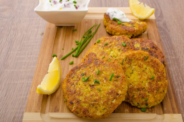 Cauliflower curry pancakes with spicy dip of Greek yogurt chives and lemon juice